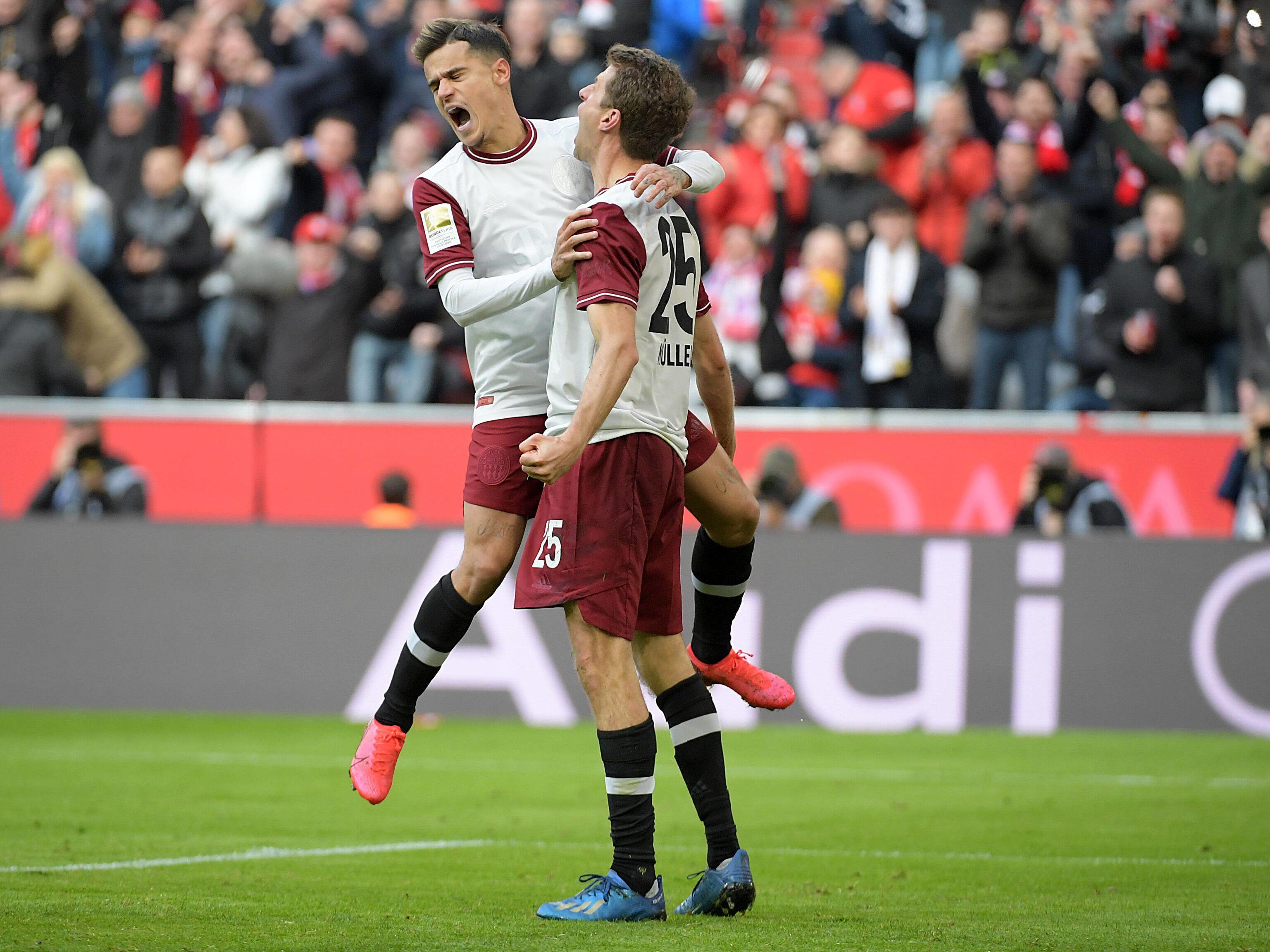 Freudenschreie: Philippe Coutinho und Thomas Müller (r.) beim Torjubel.