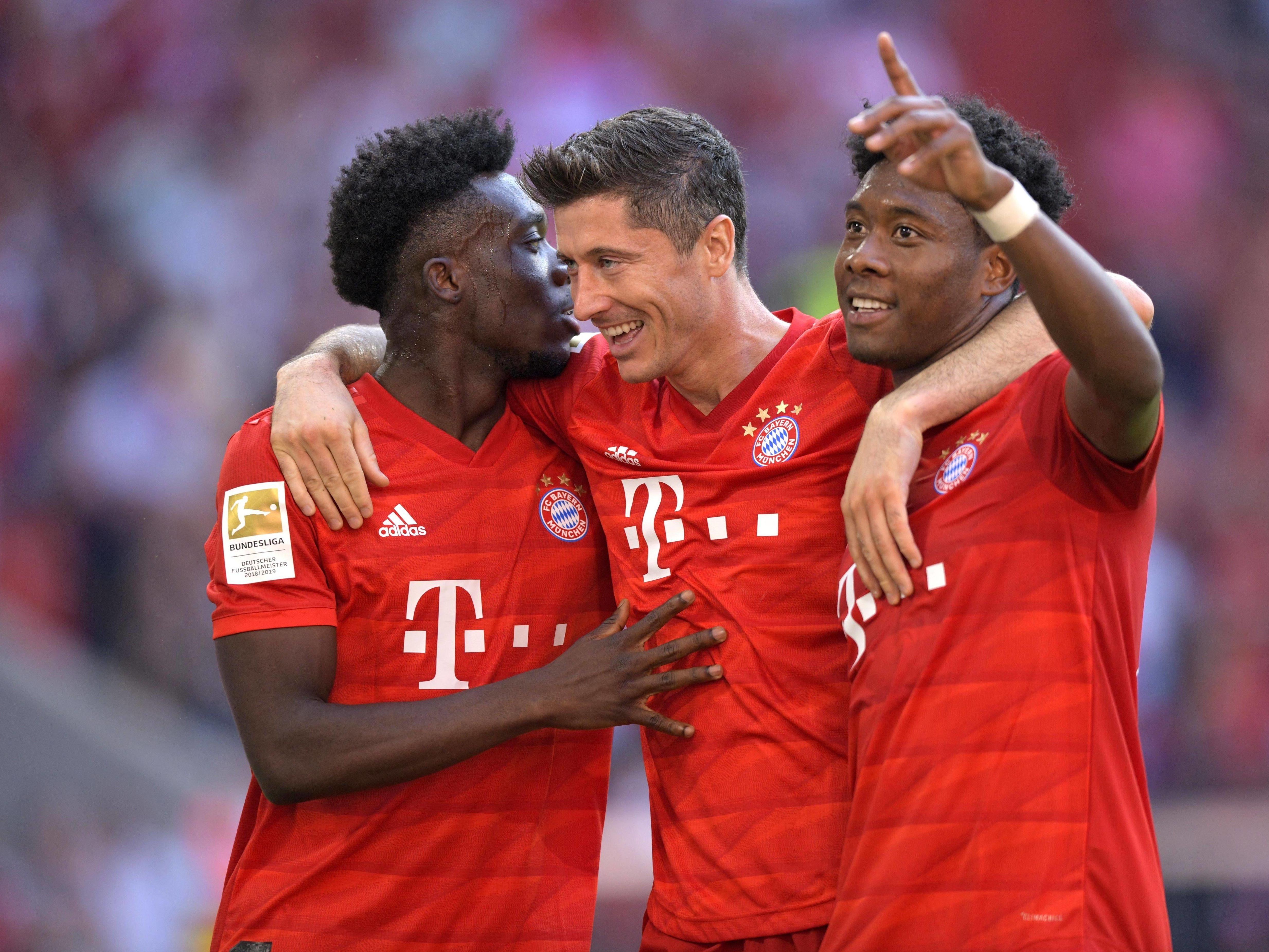 Drei Bayern-Torschützen: Davies (li.),Lewandowski und Alaba.