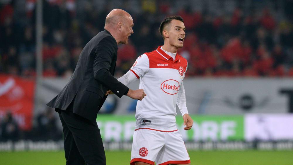 Düsseldorfs Erik Thommy (re.) hat Trainer Uwe Rösler soll überzeugt.