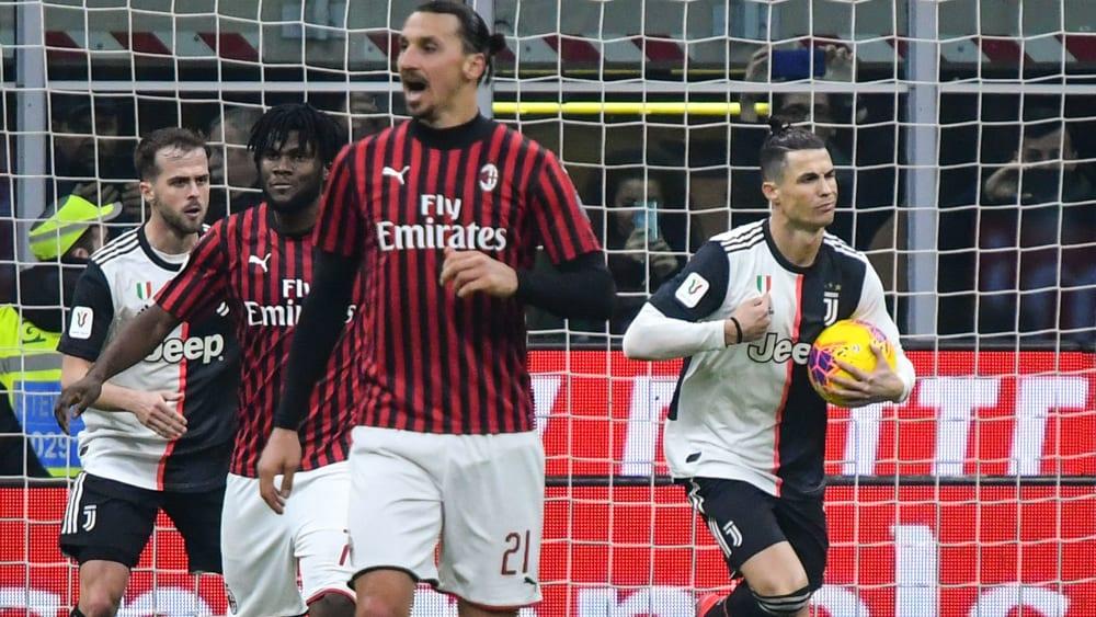 Cristiano Ronaldo (re.) nach seinem späten Ausgleich in Mailand