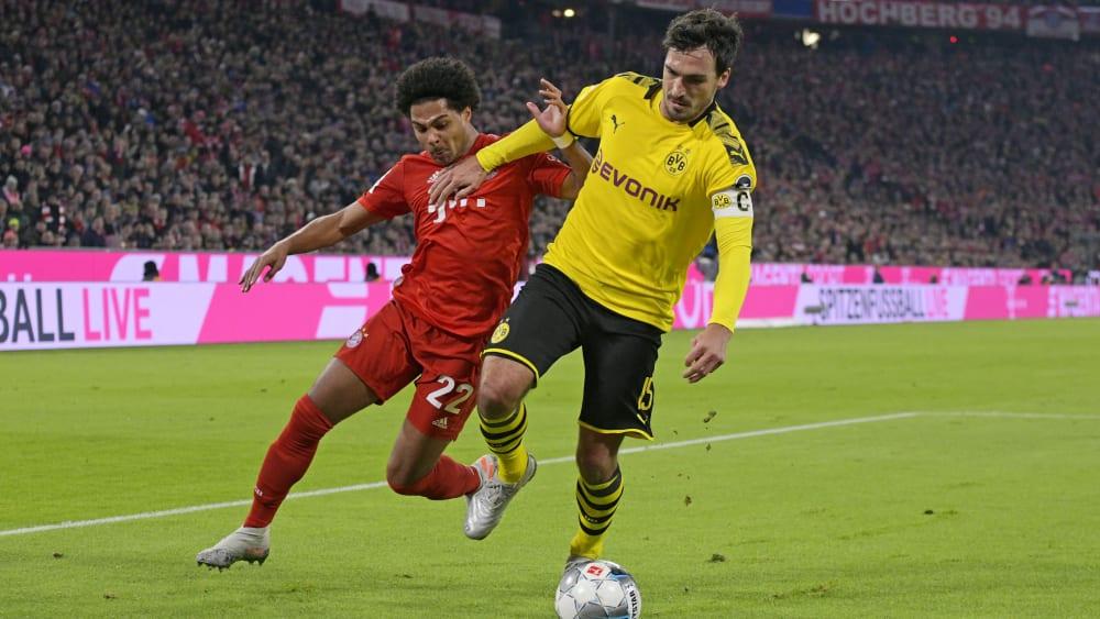 Auch das zweite Duell zwischen Bayern und Dortmund steht in dieser Saison noch aus - hier Serge Gnabry (l.) gegen Mats Hummels in der Hinrunde in München.