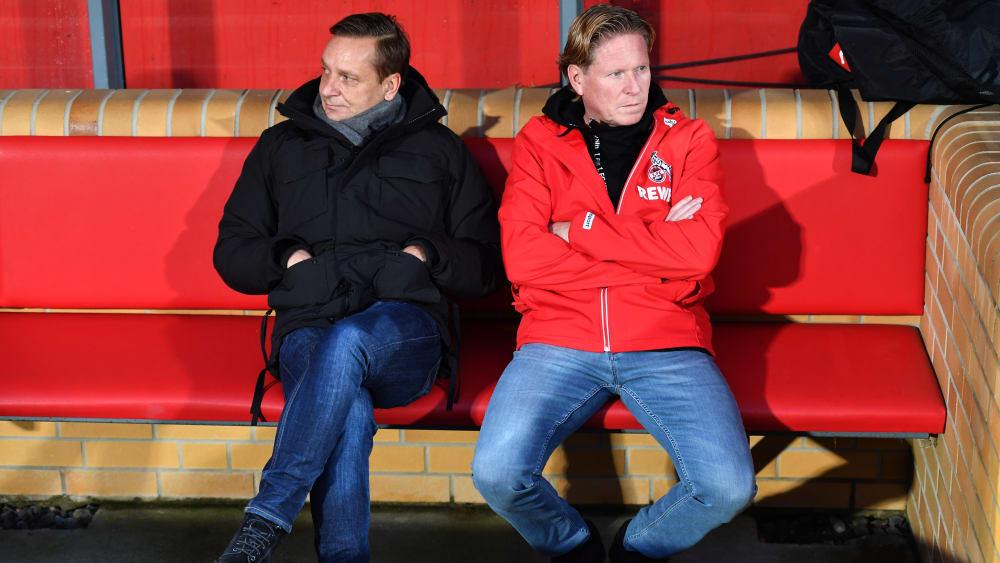 Bedient: Horst Heldt und Trainer Markus Gisdol (r.).